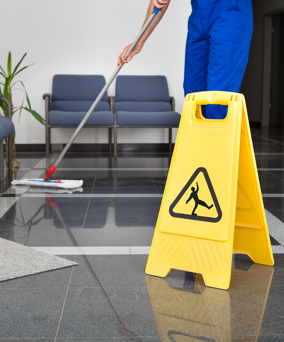 Man-With-Mop-And-Wet-Floor